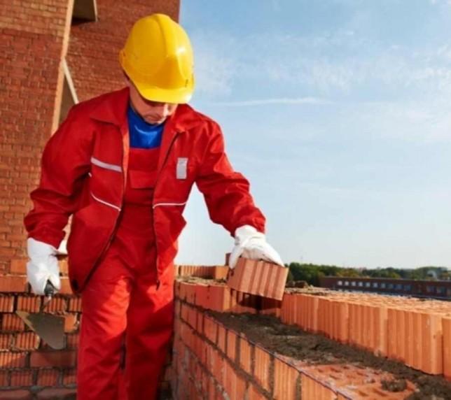 Lucru în Germania. Muncitori în construcții.